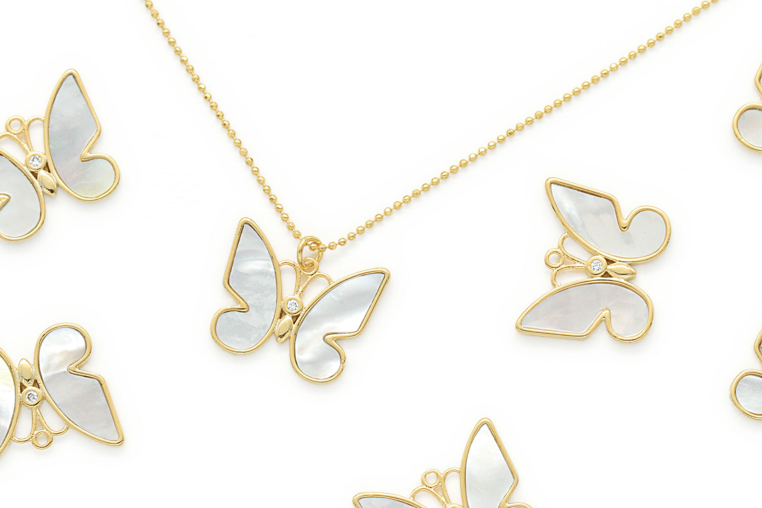 Mother-of-pearl butterfly charm, Q10-P5